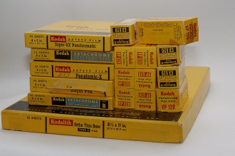 pile of old kodak film boxes