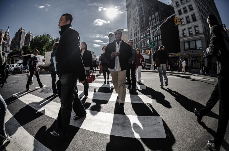 a new york city street scene using a wide angle lens to fit in more subjects