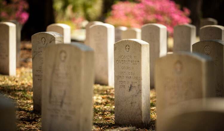 using long camera lenses can create a feeling of isolation like this headstone, which appears isolated from the others