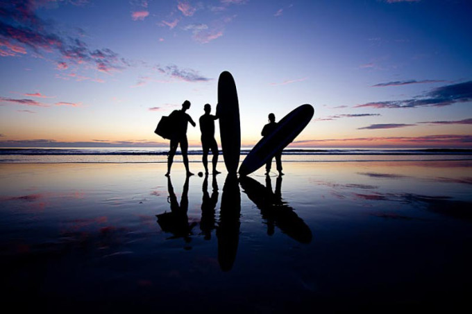 surfers with surf boards in silhouette