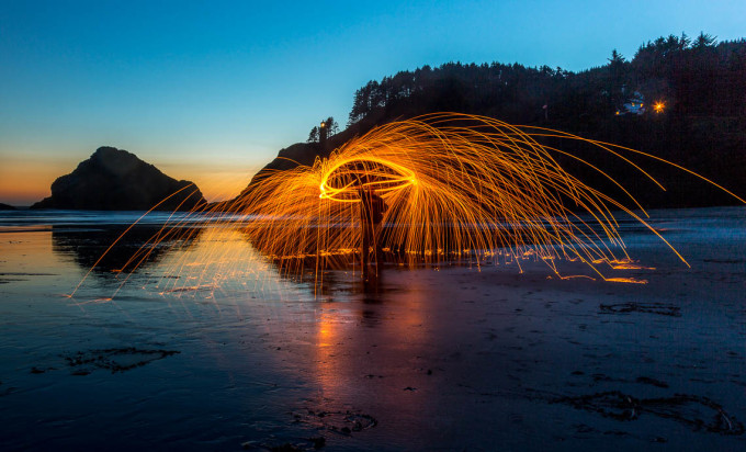 Fire spinning on the beach