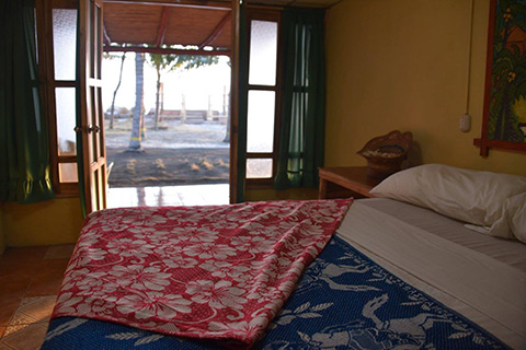 A view of the ocean from room with single bed