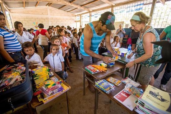 handing out school supplies in nicaragua