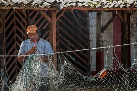 man and fishing net