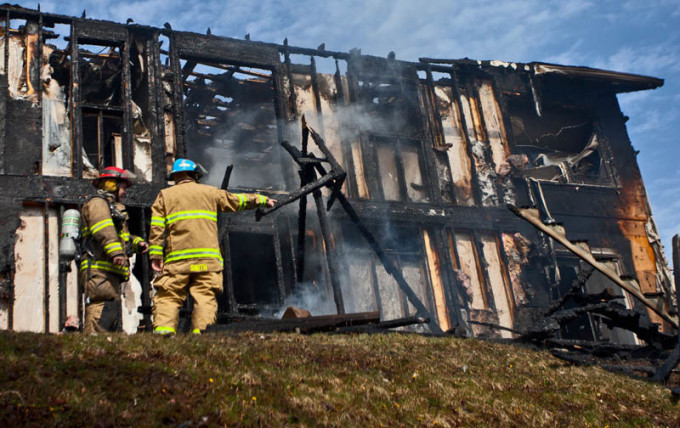 Firefighters take a look for hot spots after knocking down a fire