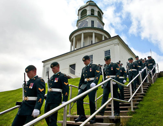 Members of the 2nd Battalion of the Royal Canadian Regiment from Gagetown file down the stairs near the town clock after a photo shoot. The Regiment was in town to participate in the upcoming Tattoo.