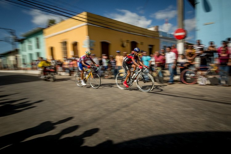 panning example of cyclists in Trinidad Cuba