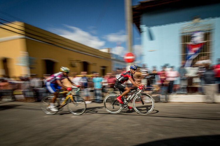 bicylists in Trinidad Cuba are shown as an example of panning