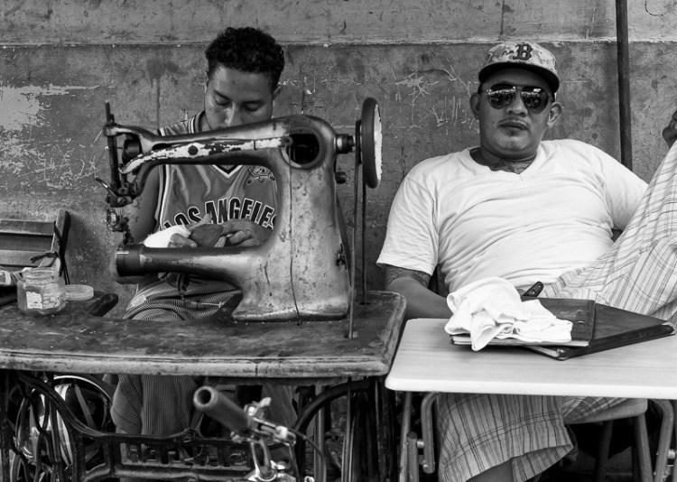 Nicaraguan men sewing