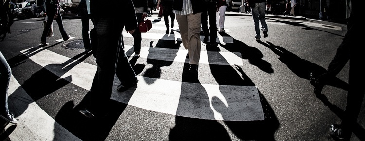Street photography of a pedestrian cross walk but a more creative photo idea to use shadows