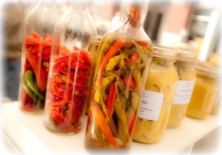 Bottles of dried peppers and canned vegetables at the market make for a colorful photo