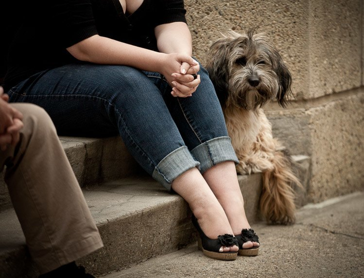 a woman and her dog sit and show their feet