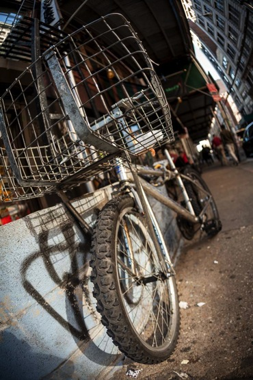 Same bicycle photographed much closer with a wide angle lens afor a more dramatic photo