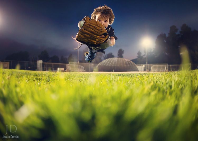 second shot of boy flying through the air to catch a baseball