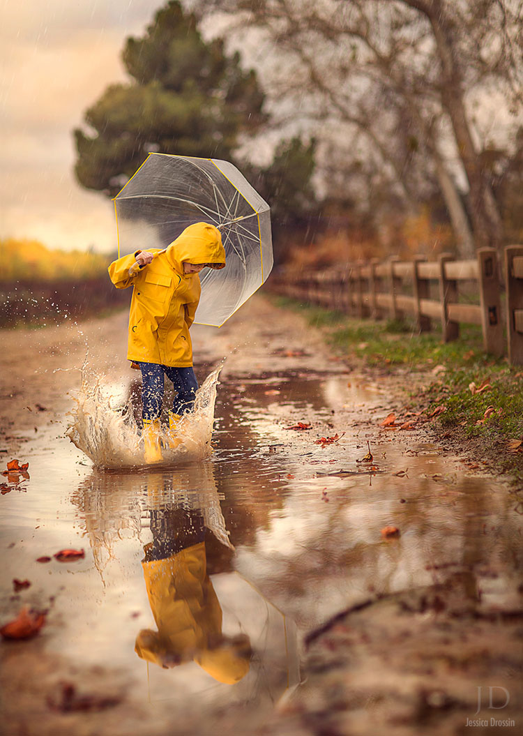 rainy day photo opportunity.  Photography of your kid in a raincoat splashing in a puddle