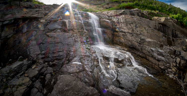 photographing a waterfall while shooting into the sun