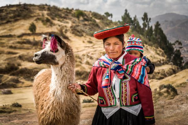 Lady with baby and llama - near Cusco Peru
