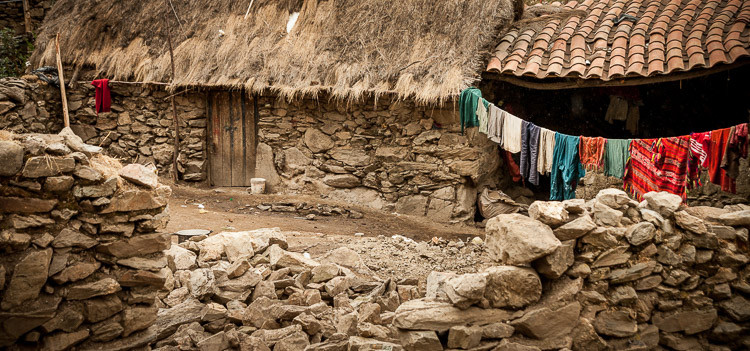 Simple rock house in remote mountain village, Peru.