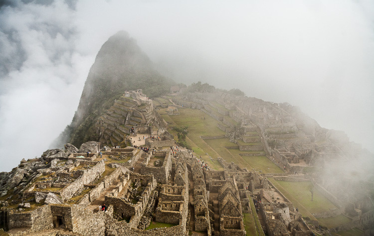 The fog lifts to reveal the magical Inca ruins of Machu Picchu, Peru.