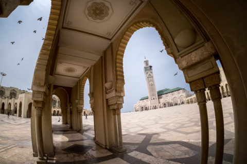 Hassan II mosque in Casablanca as shot from an archway in the square