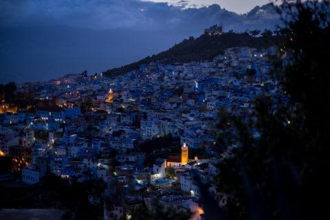 a view of the blue city Chefchaouen at night from above