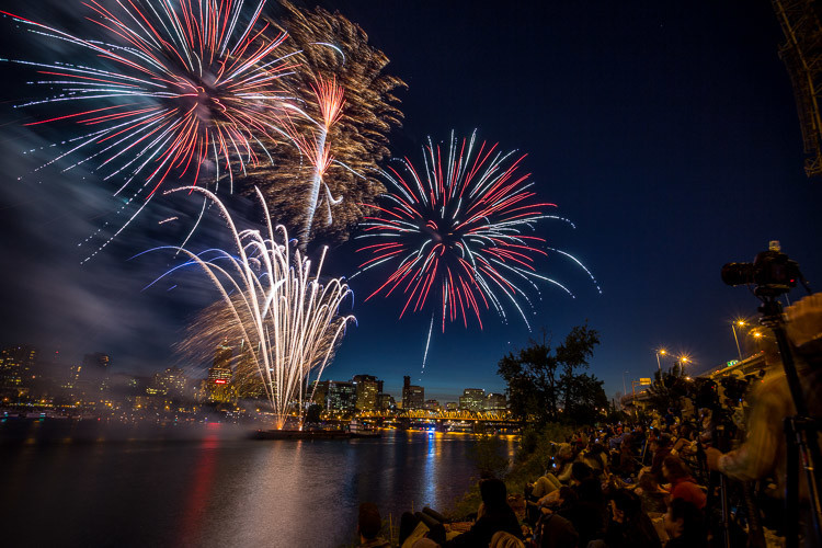 compose your photo by using the crowds in your fireworks photography to add a human element and give perspective