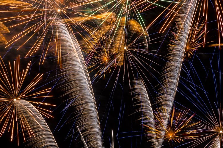 horizontal photo of fireworks bursting overhead photographed with a tight composure to make an abstract photo