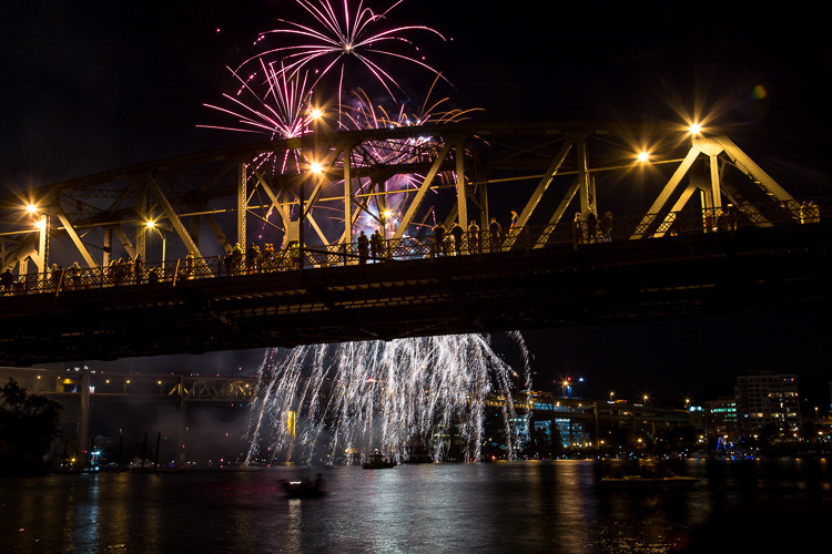 A new composition with a tigher shot with fireworks bursting and creating stars behind the bridge showing the crowd in silhouette but still not great