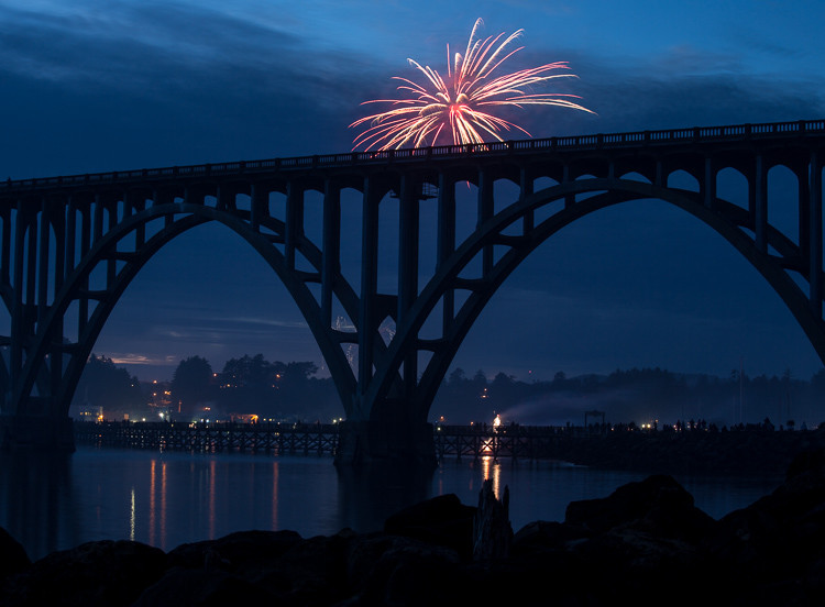 fireworks bursting too low and obstructed by bridge in the foreground
