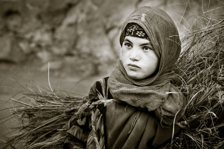 a young moroccan girl in black and white