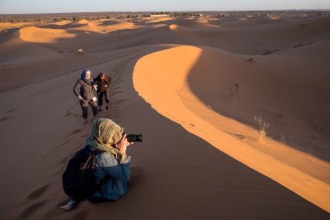 Photographers up early to photograph the sunrise over the sahara