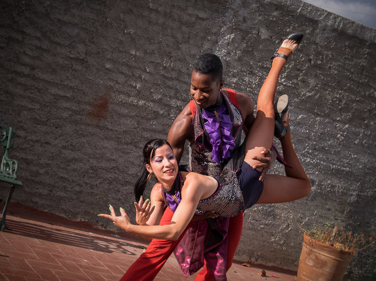 a tack sharp focused photo of Cuban dancers captured while dancing using continuous focus mode