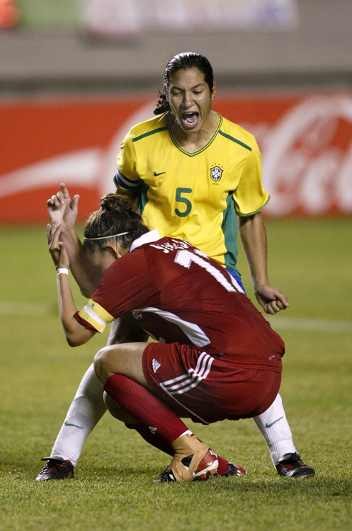 two women soccer players excited after a play