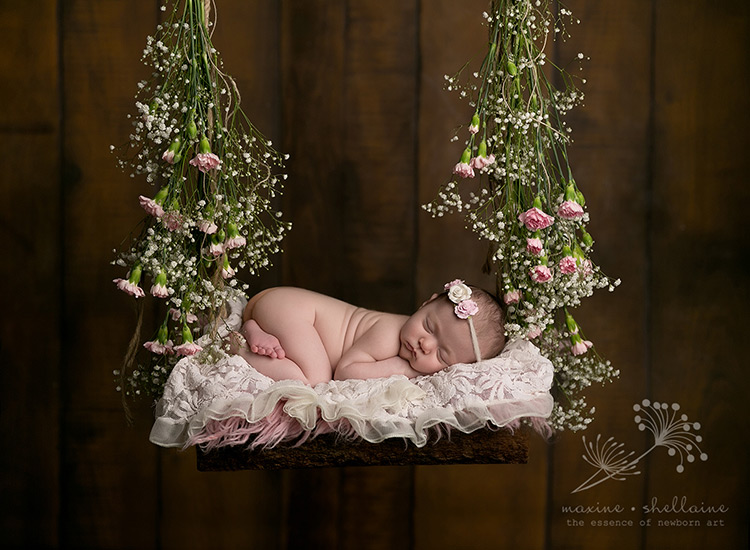 infant-baby-asleep-with-flowers