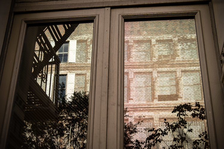 I loved the other building in the windows of this brown doorway.