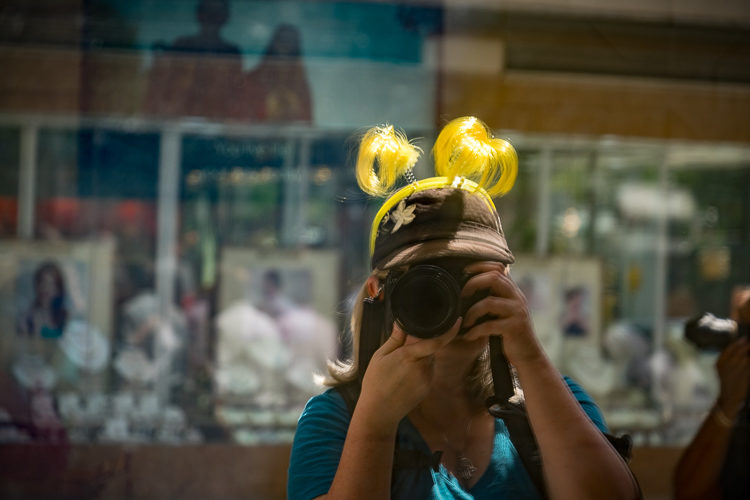 Noticed myself in a big store window and couldn't resist this selfie - complete with my yellow deely-boppers that I wear on photo walks so people don't lose me.