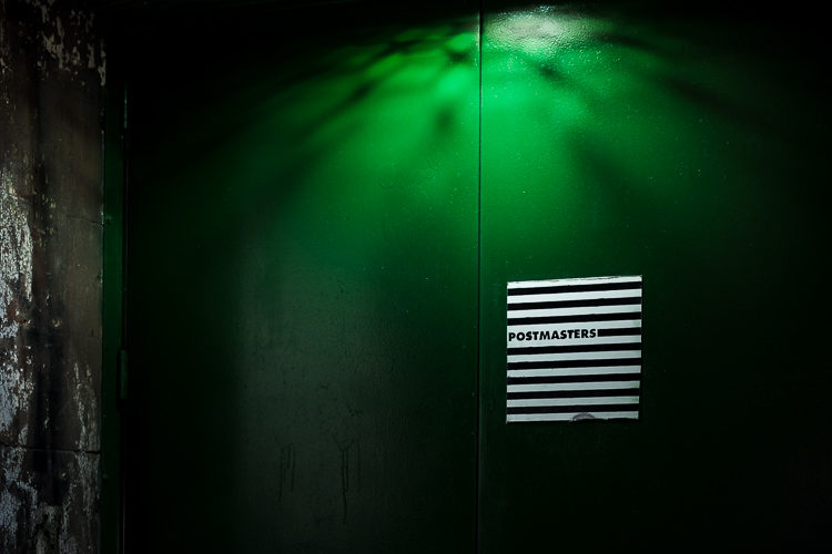 The unusual pattern of light on this green door caught my eye.