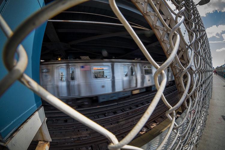A subway train rambles over the Manhattan Bridge.