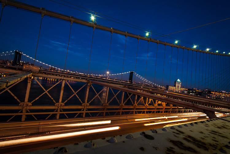 This is a single shot capturing car trails on the Brooklyn Bridge in NYC. I could not do a longer exposure or the sky would be too bright and I didn't have an ND filter.