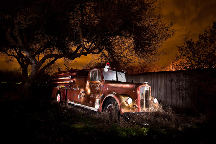 This final image is a combination of about 15 shots where I lit a different part of the firetruck each time. I used the same technique to combine them in Photoshop using layers.