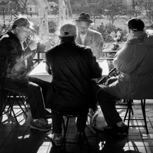street photography shot of men sitting at a table