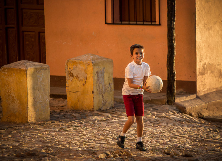 Some kids started playing soccer and I took some shots of them playing and finally - one of them stepped into that golden light!