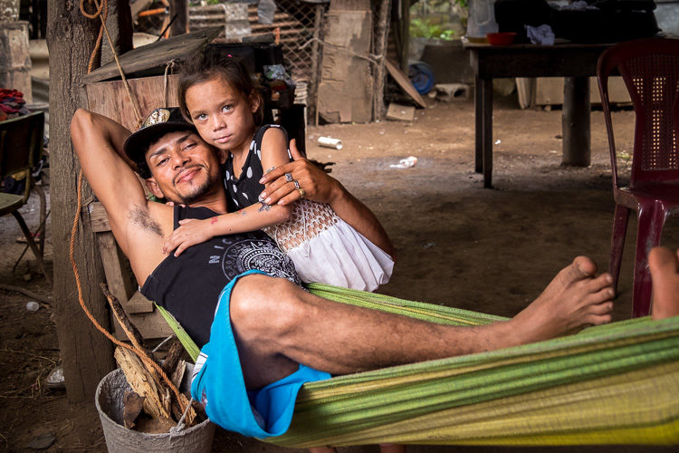 a father and his daughter in a hammock in Nicaragua.  Taken during a photography vacation