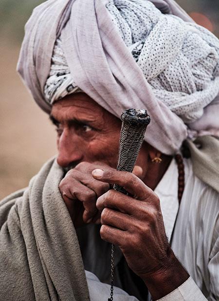 Cameleer Smoking in Pushkar India