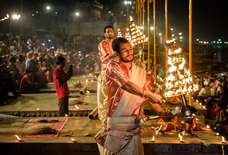 Young pandits performing the Ganga Aarti ceremony at the Dasaswamedh Ghat in Varanasi India.