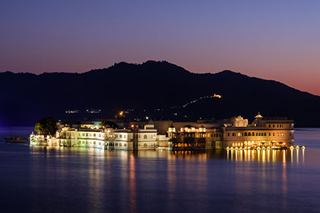Lake Palace Hotel formerly known as Jag Niwas at night in Lake Pichola at night in Udaipur