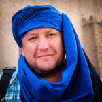 Photo tour leader Daniel Korzeniewski shown wearing a blue Moroccan Berber headscarf.