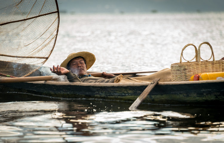 Fisherman resting in Myanmar