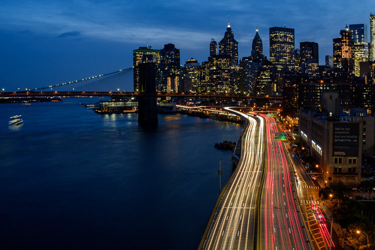 Night photo of New York during blue hour showing car light trails.  Didn't have to pack extra equipment
