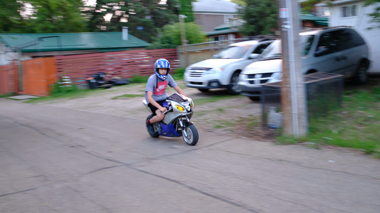 example image of a slow shutter speed and burst mode allowing panning of a motorcycle in motion
